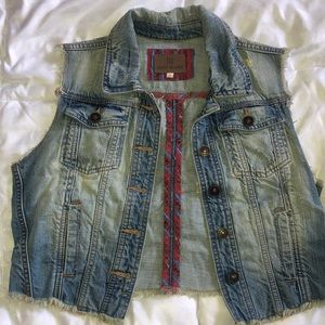 Worn sleeveless denim vest